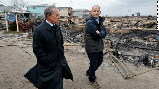 Bloomberg views damage in October 2012 in the Breezy Point area of Queens, where a fire destroyed about 80 homes as a result of Superstorm Sandy. Sandy killed at least 113 people in the United States and heavily damaged New York's infrastructure.