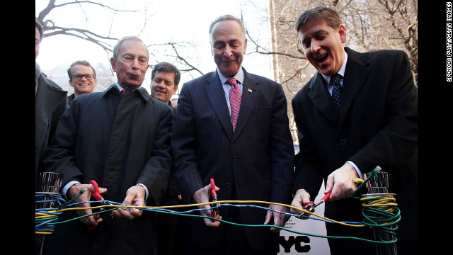 From left, Bloomberg, New York Sen. Charles Schumer, and Ben Fried, chief information officer for Google, cut Ethernet cables at a news event where it was announced that free Wi-Fi would be provided to the Manhattan neighborhood of Chelsea in January 2013.