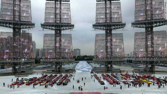 This image shows Ferrari cars in a square in Guangzhou, south China's Guangdong province on November 22, 2012. Chinese cities including Guangzhou and Shanghai saw double digit growth in the value of prime property, according to the Knight Frank report.<!-- --> </br>