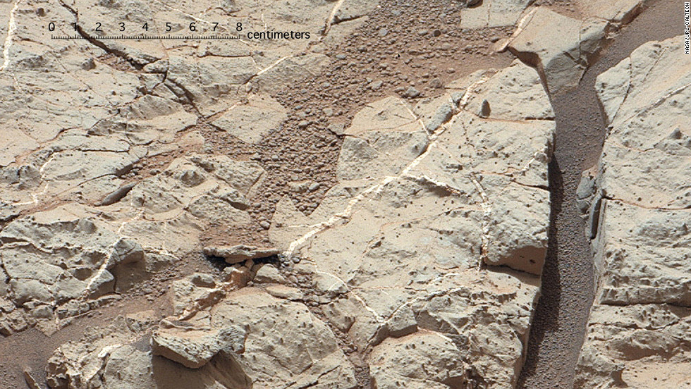 "The 2,000-pound Mars rover Curiosity made its landing on Mars on August 6, 2012, and has been sending back fascinating images and data ever since. Mars once had conditions favorable for microbial life, NASA scientists announced Tuesday, March 12, 2013. One piece of evidence for that conclusion comes from this area of the Martian surface, nicknamed ""Sheepbed."" It shows veins of sediments that scientist believe were deposited under water and was an environment once hospitable to life. See more images sent by the rover:"