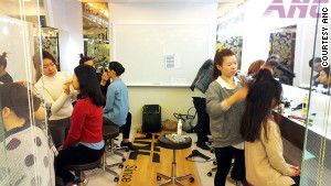 Students at Seoul flight attendant academies practice getting the right look.