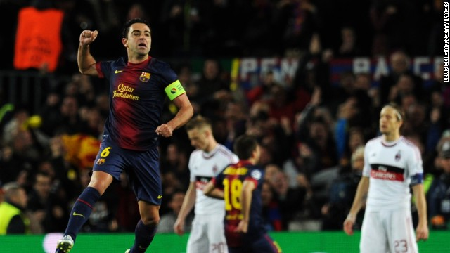 Xavi, captaining the side in place of Carles Puyol, jumps for joy after Messi's early strike. Barcelona looked a completely different side to that which lost at San Siro three weeks ago as it piled the pressure on Milan.