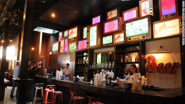 Screens light up the bar at the VEVO TV Launch on March 12.