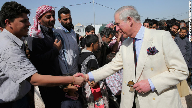 Prince Charles meets Syrian refugees in the King Abdullah Refugee Camp, 2 kilometers from the Syrian border.