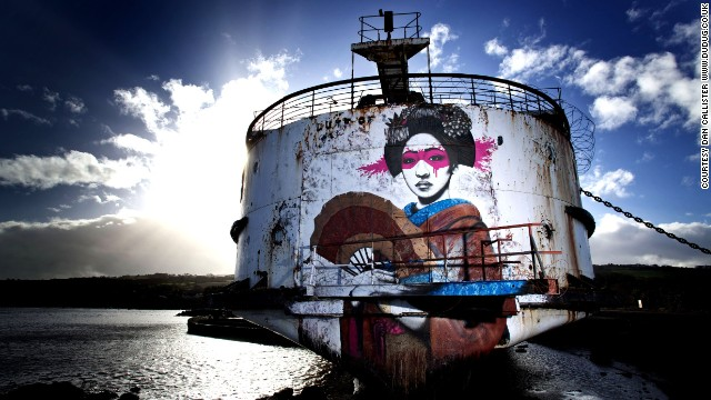 "Irish artist Fin Dac, created this piece, called ""Mauricamai,"" which stretches the height of the ship's stern. ""I create my art to keep myself happy. If others like it then that's a great by-product,"" he said."