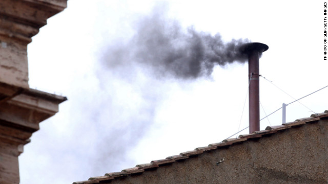 Black smoke billows from the chimney, indicating that the College of Cardinals has failed to elect a new pope on March 13.