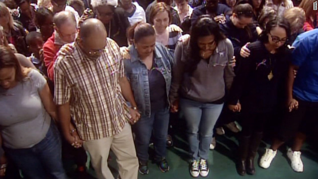 Dozens wore ribbons at a church vigil to pray for her safe return.