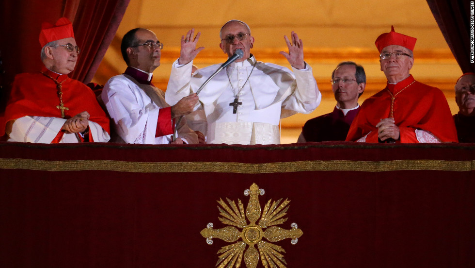 Newly elected Pope Francis speaks to the crowd from the central balcony of St. Peter's Basilica at the Vatican on Wednesday, March 13. Argentinian Cardinal Jorge Mario Bergoglio was elected as the first pontiff from Latin America and will lead the world's 1.2 billion Catholics.