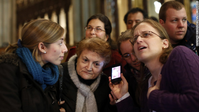 Florencia Silva, right, of Trumbull, Connecticut, and Valentina Bruner of Peru tune in to a webcast of newly elected Pope Francis at St. Patrick's Cathedral in New York.