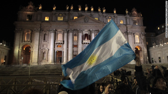 People in St. Peter's Square wave Argentina's flag after the new pope was chosen.