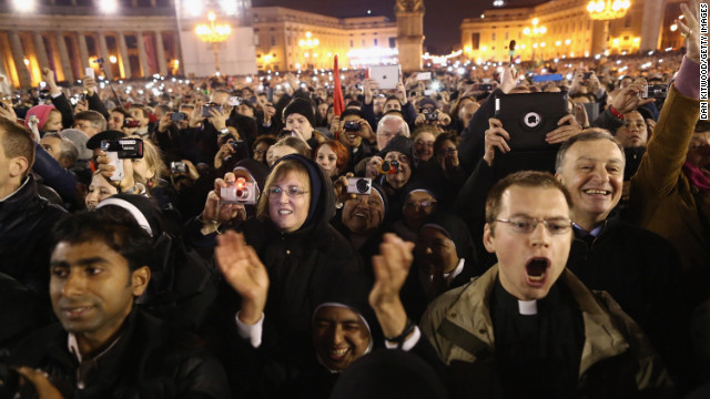 People react to the newly elected pope's appearance on the balcony.
