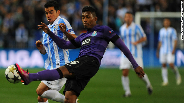 Malaga's Javier Saviola goes up against Porto's Alex Sandro with the Spanish club aiming to overturn a one-goal deficit from the first leg. 