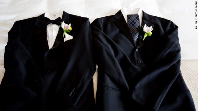 A wedding without a gown provides the chance to give two suits the royal treatment. In other words, avoid the temptation to go matchy-matchy and use accessories like ties, bow ties and cuff links to distinguish one from the other.