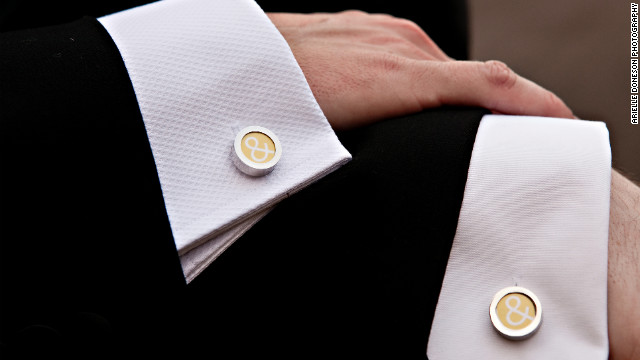 "Detail shots offer a chance to capture the symbols and subtle touches of a wedding. ""Photographing a groom's cuff links comes straight (ahem) from the traditional playbook,"" Hamm said. Here, that classic shot is reinvented by capturing different men's shirts to signify that two people are in the frame."
