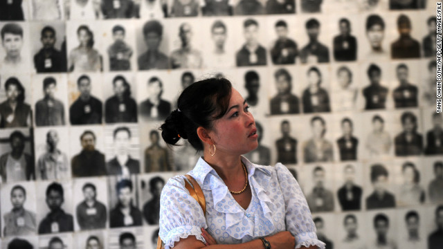 A Cambodian woman looks at portraits of victims of the Khmer Rouge at the Tuol Sleng genocide museum in Phnom Penh on November 17, 2011.