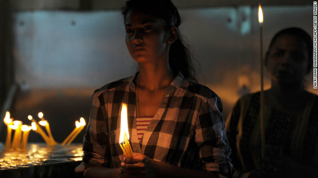 Catholics take part in a Mass in Colombo, Sri Lanka, on Thursday, March 14. The faithful celebrated the election of the first non-European pope in nearly 1,300 years of church history.