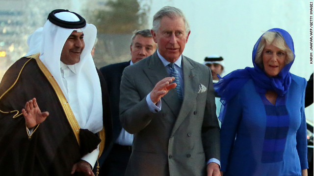Qatar's Sheikh Abdul Rahman Bin Saud Al Thani escorts Prince Charles and his wife Camilla in Doha on Wednesday.