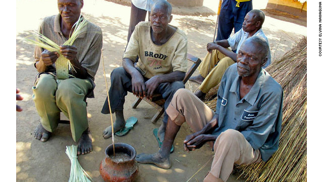 "Statistically Africa's biggest drinkers, Ugandans enjoy a pot of ajono, a semi-fermented beer. ""Getting a round in"" here just involves passing the straw."