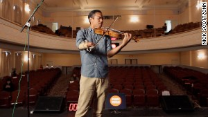 Anantawan on the stage of the Camden Opera House in Camden, Maine, where he spoke at the PopTech conference.