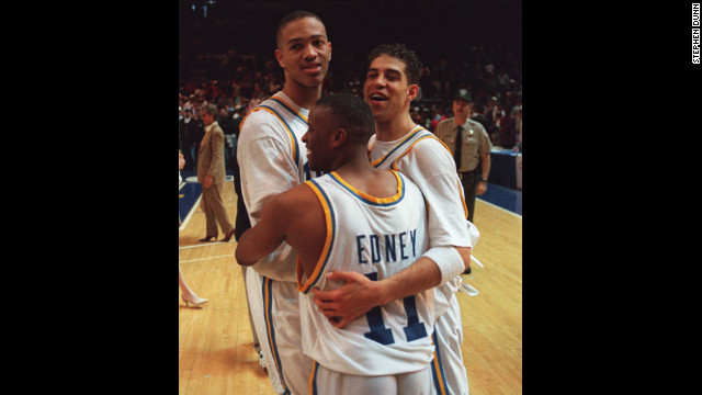 From left, UCLA players J.R. Henderson, Tyus Edney and Toby Bailey celebrate after beating UConn 102-96 in the NCAA West Regional final in Oakland, California, on March 25, 1995. UCLA went on to take the title by defeating Arkansas 89-78.