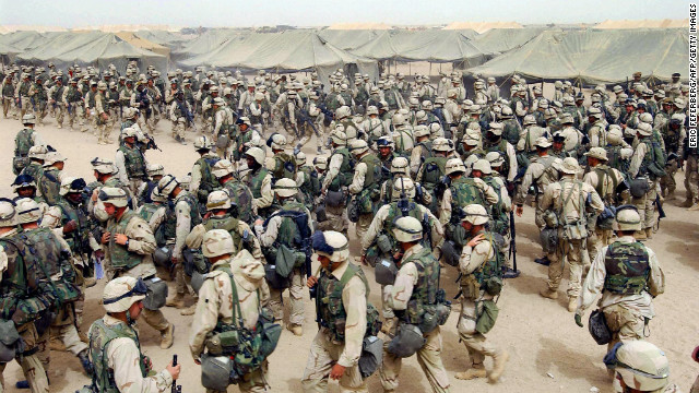 U.S. Marines in northern Kuwait gear up after receiving orders to cross the Iraqi border on March 20, 2003. It has been 10 years since the American-led invasion of Iraq that toppled the regime of Saddam Hussein. Look back at moments from the war and the legacy it left behind. For more, view CNN's complete coverage of the Iraq War anniversary.