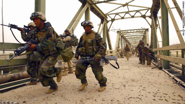 Members of the 3rd Battalion, 4th Marines, storm Diyala Bridge in Baghdad on April 7, 2003. 