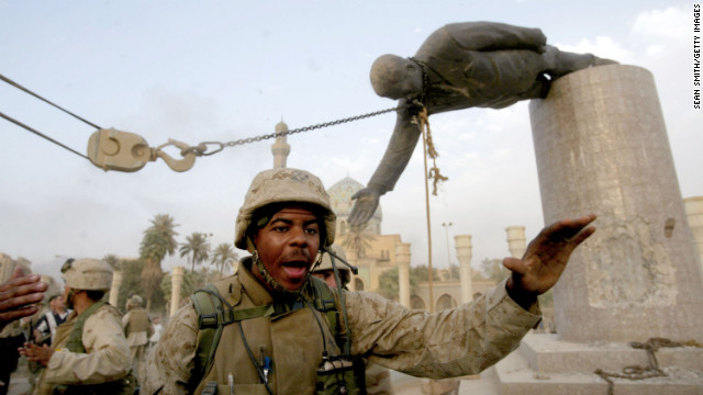 Marines pull down a statue of Saddam Hussein, a symbolic finale to the fall of Baghdad, on April 9, 2003.