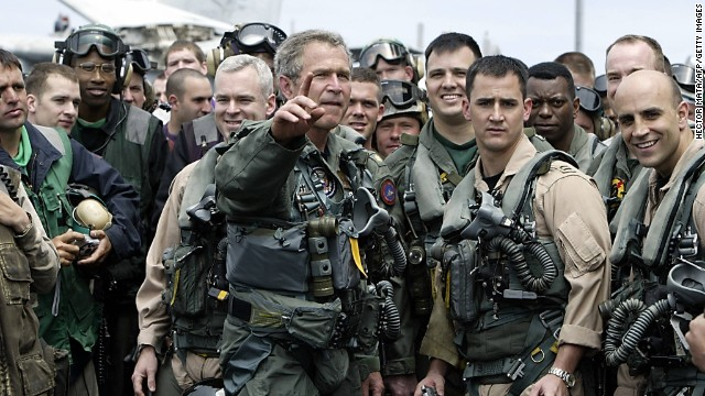 Dressed in a flight suit, President Bush meets pilots and crew members of the aircraft carrier USS Abraham Lincoln who were returning to the United States on May 1, 2003, after being deployed in the Gulf region.