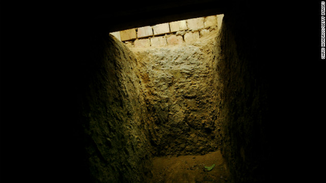 "The entrance to the ""spider hole"" where Saddam Hussein was hiding in Ad Dawr is seen from the inside on December 15, 2003."