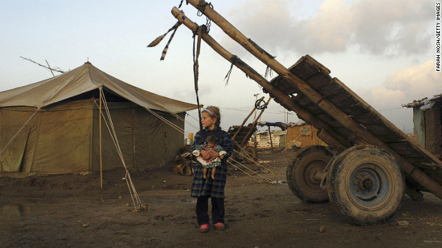 Eman Mohammed, 7, stands in the Kurdish refugee camp in Kirkuk on January 7, 2004. Since 2003, thousands of internally displaced Kurds have returned to Kirkuk.