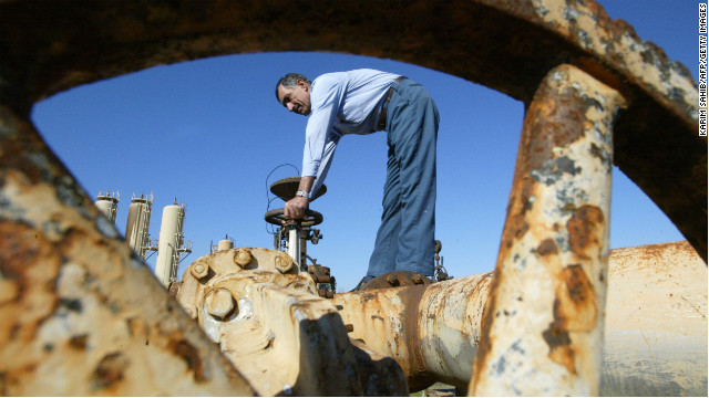 A worker turns a valve at the Shirawa oil field outside the northern city of Kirkuk on January 19, 2004. The security of Iraq's oil infrastructure had improved, but exports through the region's main pipeline had yet to resume.
