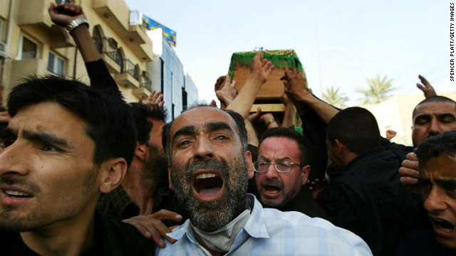 Mourners carry coffins in Karbala on March 3, 2004. A day after a series of bombs killed dozens and injured hundreds during the Ashura ceremony in the Shiite holy city of Karbala, Shiite Muslims began burying their dead.