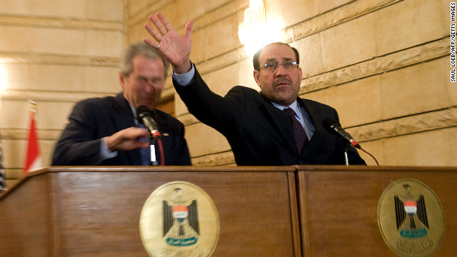 "Iraqi Prime Minister Nuri al-Maliki tries to block a shoe thrown at President Bush during a news conference in Baghdad on December 14, 2008. The Iraqi journalist who threw the shoes missed the president but could be heard yelling in Arabic, ""This is a farewell ... you dog!"""