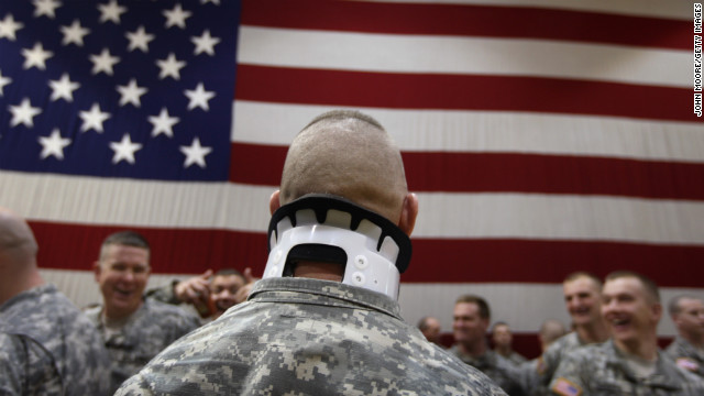 Pfc. Jeremy Tomlinson, who was wounded a year before in Iraq, waits with fellow soldiers to greet returning comrades in Fort Carson, Colorado, on January 28, 2008. About 3,800 soldiers were coming home after a 15-month tour of duty.