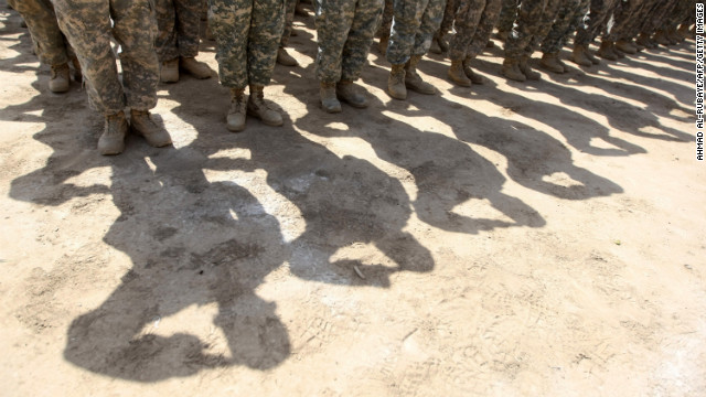 U.S. soldiers salute during a handover ceremony of the entry points of Baghdad's Green Zone, now referred to as the International Zone, to Iraqi control inside the heavily fortified compound in Baghdad on June 1, 2010.