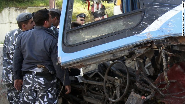 Lebanese security forces inspect the scene of a bus crash in the town of Kahaleh, 10 km east of Beirut on March 15, 2013.