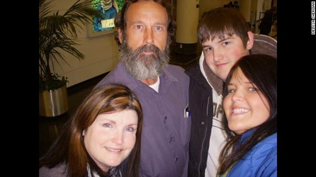 Leo Sherman is reunited with his wife and two children at Chicago's O'Hare Airport.