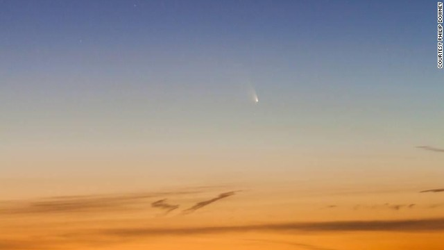"Science journalist Philip Downey snapped this photo of Comet Pan-STARRS in Port Dalhousie, Ontario, looking west over Lake Ontario on March 14. ""A cold wind off the lake doesn't begin to describe the conditions,"" he says. ""But it was definitely our best chance to see it, so we took it."""