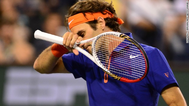Roger Federer bowed out at the quarterfinal stage following a straight sets defeat by Rafael Nadal.