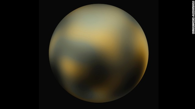 "This image shows the surface of Pluto as constructed from multiple NASA Hubble Space Telescope photographs. Although deemed a planet at its discovery in 1930, scientists decided later to reclassify it as a ""dwarf planet."""