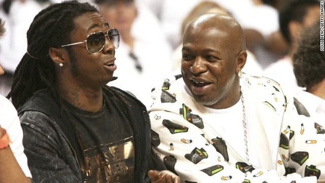 Lil Wayne and Baby AKA Birdman watch the New Jersey Nets play the Miami Heat during the NBA playoffs in 2006.