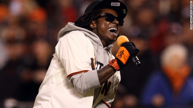 Lil Wayne sings &quot;Take Me Out to the Ball Game&quot; during the seventh-inning stretch as the San Francisco Giants took on the St. Louis Cardinals during the National League Championship Series in 2012.