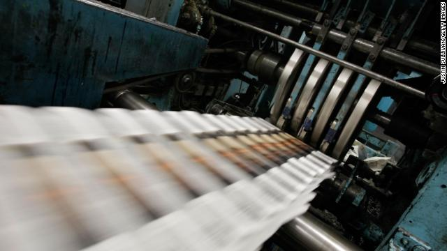  A printing press spins out copies of a daily newspaper, an object handled by fewer and fewer people in a digital age, says Bob Greene