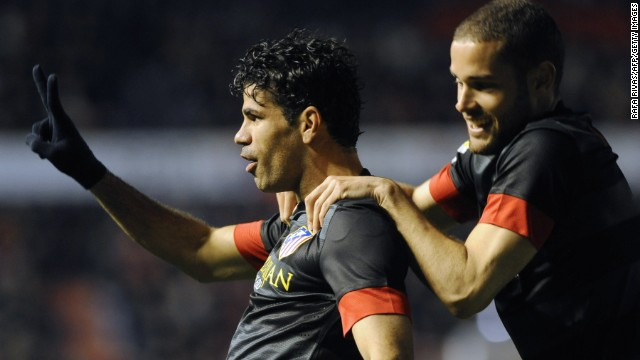 Diego Costa scored twice as Atletico Madrid kept up the pressure on second place Real Madrid with a 2-0 win at Osasua. Diego Simeone's side is just one point behind Real following its latest victory.