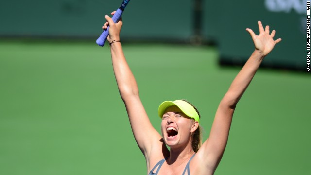 Sharapova celebrates after winning the title in just 81 minutes -- it was her first triumph since the 2012 French Open.