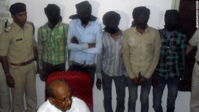 The five hooded gang-rape suspects are paraded in front of reporters in Datia on Sunday.