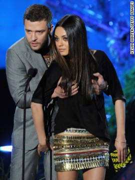"Timberlake presents an award with his ""Friends with Benefits"" co-star Mila Kunis during the 2011 MTV Movie Awards."