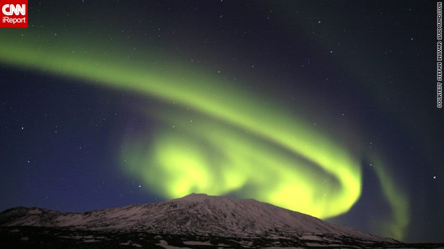 A spectacular solar event over the weekend provided a stunning showing of the northern lights, or aurora borealis. This image by Stefan Ingvar Gudmundsson from Iceland captures the lights <a href='http://ireport.cnn.com/docs/DOC-943369'>appearing to curl</a> around the Snaefellsjokull glacier.