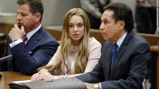 Lindsay Lohan appears in court with her attorneys Anthony Falangetti, left, and Mark Heller in Los Angeles on Monday, March 18. She entered pleas of no contest on two misdemeanor charges relating to a traffic accident last summer, and she did not challenge the finding that she violated her shoplifting probation with those convictions.