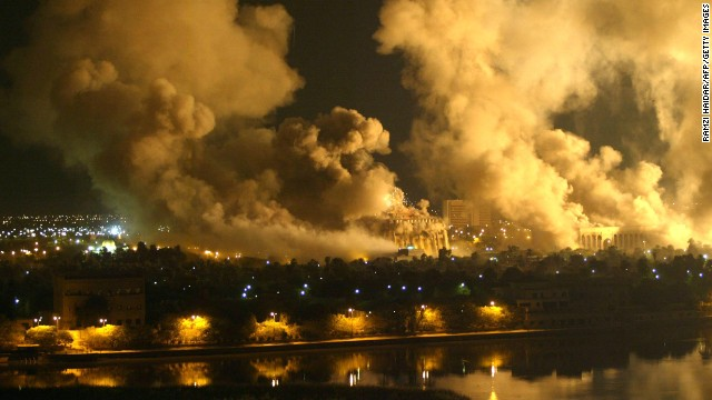  Smoke covers the presidential palace compound in Baghdad 21 March 2003 during a massive US-led air raid on the Iraqi capital. Smoke billowed from a number of targeted sites, including one of President Saddam Hussein's palaces, an AFP correspondent said. AFP PHOTO/Ramzi HAIDAR (Photo credit should read RAMZI HAIDAR/AFP/Getty Images) 